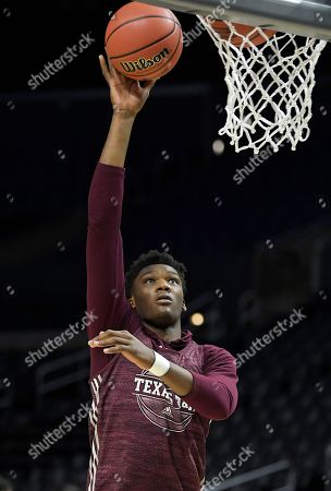 Texas A&M forward Robert Williams shoots during practice at the NCAA men's college basketball tournament, in Los Angeles. Texas A&M plays Michigan in a regional semifinal on Thursday