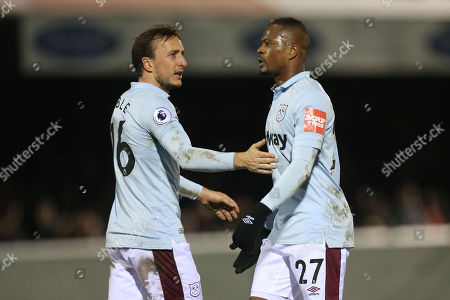 Mark Noble and Patrice Evra of West Ham during Dagenham & Redbridge vs West Ham United, Save The Daggers Friendly Match Football at the Chigwell Construction Stadium on 21st March 2018