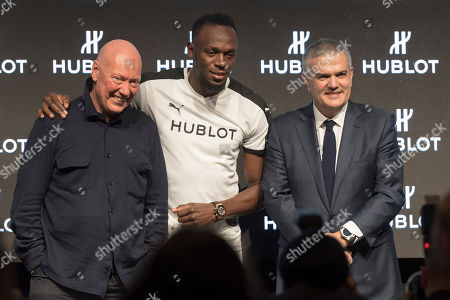 (L-R) Jean-Claude Biver, Chairman of Hublot, Usain Bolt and Ricardo Guadalupe, CEO of Hublot, pose during a press conference at the world watch and jewellery show Baselworld in Basel, Switzerland, 21 March 2018.