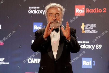 Director Gianni Amelio arrives to attend the David Donatello awards ceremony in Rome