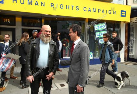 On, San Francisco Mayoral candidate Mark Leno, center, campaigns in the Castro district of San Francisco