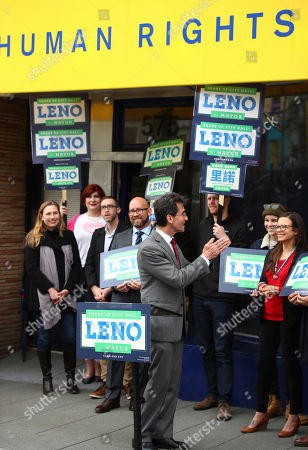 On, San Francisco Mayoral candidate Mark Leno, center, applauds after speaking to his supporters in San Francisco