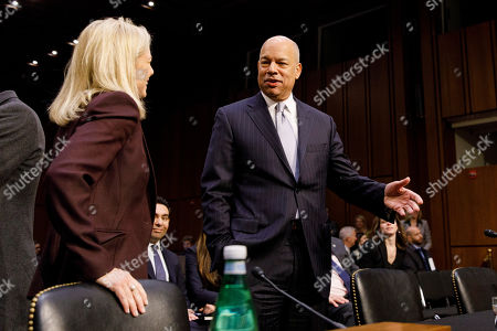 Former Secretary of Homeland Security Jeh Johnson, right, converses with Secretary of Homeland Security Kirstjen Nielsen prior to a United States Senate Intelligence Committee hearing regarding election security on Capitol Hill in Washington, D.C..