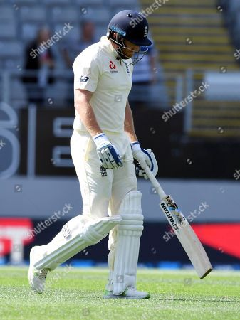 England's Jonathan Bairstow walks, out for 0, caught and bowled by New Zealand's Tim Southee during their first cricket test in Auckland, New Zealand