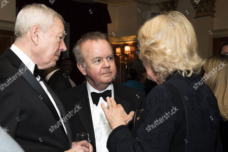 Camilla Duchess of Cornwall (R) with authors Alan Johnson (L) and Ian Hislop as they attend a reception to mark The National Literacy Trust's 25th anniversary at Plaisterers' Hall