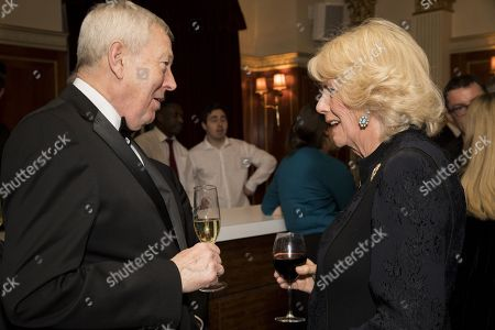 Camilla Duchess of Cornwall (R) with author Alan Johnson attends a reception to mark The National Literacy Trust's 25th anniversary at Plaisterers' Hall on March 21, 2018 in London, England.