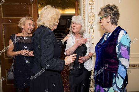 Camilla Duchess of Cornwall (second left) with authors Jilly Cooper (C) and Prue Leith as they attend a reception to mark The National Literacy Trust's 25th anniversary at Plaisterers' Hall on March 21, 2018 in London, England.