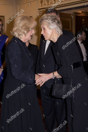 Camilla Duchess of Cornwall (L) with author Joanna Trollope as they attend a reception to mark The National Literacy Trust's 25th anniversary at Plaisterers' Hall on March 21, 2018 in London, England.