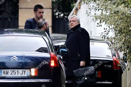 Thierry Herzog (R), lawyer of former French President Nicolas Sarkozy, arrives at his home in Paris, France, 22 March 2018. After more than 24 hours of questioning on 21 March 2018, the former president was indicted for passive corruption, illegal financing of an electoral campaign, and fencing of public Libyan founds. This indictment inscribes itself in the suspicion regarding Nicolas Sarkozy's founding of his campaign during the presidential elections 2007.