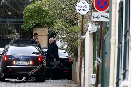 Thierry Herzog, a lawyer for former French President Nicolas Sarkozy, arrives at Sarkozy's home in Paris, . Sarkozy was handed preliminary charges Wednesday over allegations he accepted millions of euros in illegal campaign funding from the late Libyan leader Moammar Gadhafi