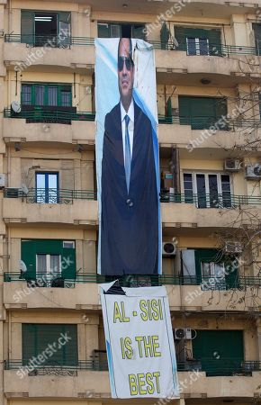 An election banner for Egyptian President Abdel-Fattah el-Sissi, hangs in Tahrir Square, which was the focal point of the Jan. 25, 2011 Egyptian uprising that toppled autocrat Hosni Mubarak, in Cairo, Egypt, . President Abdel-Fattah el-Sissi, the general-turned-president, will stand for re-election next week against Moussa, a little-known politician who has made no effort to challenge him