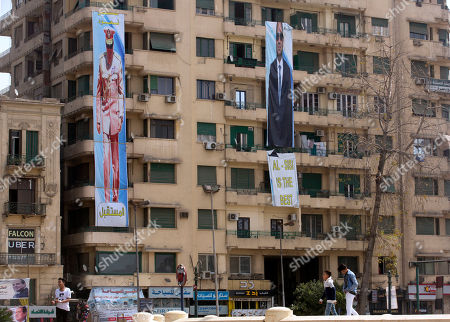 Election banners for Egyptian President Abdel-Fattah el-Sissi, hang in Tahrir Square, which was the focal point of the Jan. 25, 2011 Egyptian uprising that toppled autocrat Hosni Mubarak, in Cairo, Egypt, . President Abdel-Fattah el-Sissi, the general-turned-president, will stand for re-election next week against Moussa, a little-known politician who has made no effort to challenge him