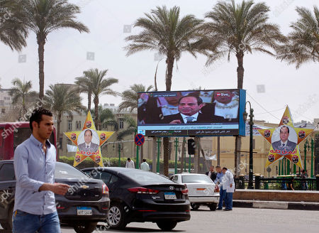 A giant screen and banners show Egyptian President Abdel-Fattah el-Sissi, in Tahrir Square, which was the focal point of the Jan. 25, 2011 Egyptian uprising that toppled autocrat Hosni Mubarak, in Cairo, Egypt, . El-Sissi, the general-turned-president, will stand for re-election next week against Moussa Mustafa Moussa, a little-known politician who has made no effort to challenge him