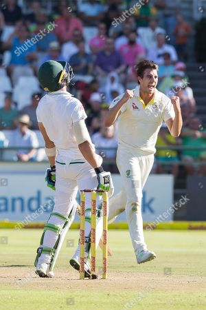 Faf du Plessis of South Africa looks to the heaven while Pat Cummins of Australia celebrates taking his wicket during a Test Match between South Africa and Australia at Newlands Stadium, in Cape Town, South Africa
