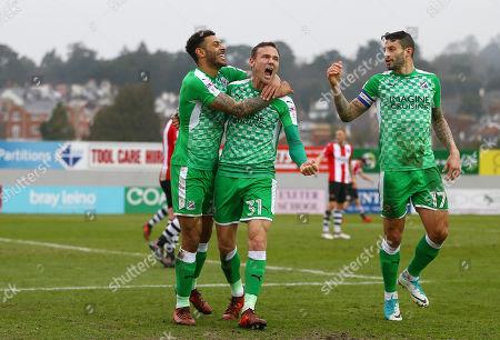 Kaiyne Woolery (left) of Swindon Town celebrates scoring a goal with Matthew Taylor of Swindon Town