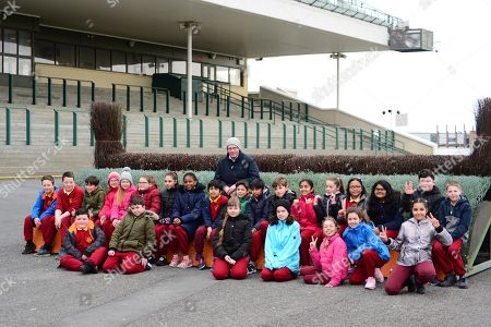 Stock Image of GALWAY RACECOURSE. Horse Racing Ireland Schools Day. Racetrack Manager Michael Moloney with pupils from Scoil San Phroinsias, Tirellan.