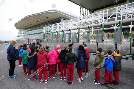 GALWAY RACECOURSE. Horse Racing Ireland Schools Day. Racetrack Manager Michael Moloney with pupils from Scoil San Phroinsias, Tirellan inspecting the starting stalls.