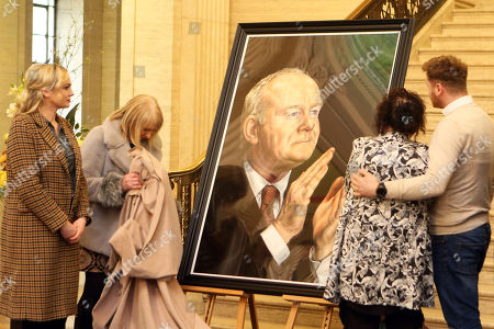 Family members unveil a portrait of the former Sinn Fein Deputy First Minister Martin McGuinness in Parliament Building, Belfast, Northern Ireland, Britain, 22 March 2018. McGuinness who resigned as deputy First Minister in a protest over the Renewable Heat Incentive scandal, died on 21 March 2017, aged 66.