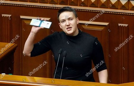 Ukrainian lawmaker Nadiya Savchenko shows her deputy card a parliament session in Kiev, Ukraine, 22 March 2018. Ukrainian Parliament gave consent to the lifting of parliamentary immunity, detention, and arrest of a non-faction People's Deputy Nadiya Savchenko. Savchenko was on 15 March expelled from the parliament's national security and defense committee.