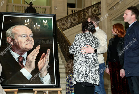 Bernie McGuinness, widow of the former deputy First Minister, Martin McGuinness, and her family unveil his portrait at Parliament Buildings.