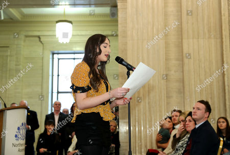 Stock Picture of Cara McGuinness, the grand-daughter of former deputy First Minister, Martin McGuinness, sings 'The Voyage' before the unveiling of his portrait at Parliament Buildings.