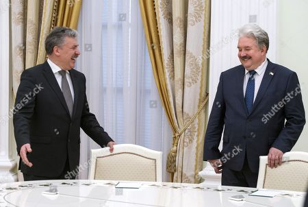 From the Communist Party and the 'People's patriotic forces of Russia', director of the Lenin State Farm Pavel Grudinin (left) and from the party 'Russian People's Union' Sergei Baburin (right) during the meeting