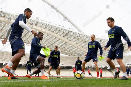 Stock Photo of (L-R) Swiss' national team soccer players Manuel Akanji, Jacques Francois Moubandje, Fabian Frei, Michael Lang and Mario Gavranovic in action during a training session at the Olympic stadium, in Athens, Greece, 22 March 2018. Switzerland will face Greece in their International Friendly soccer match on 23 March 2018.