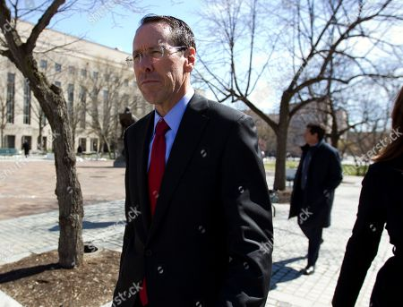 AT&T CEO Randall Stephenson leaves the federal courthouse, in Washington. The Trump administration is facing off against AT&T to block the telephone giant from absorbing Time Warner, in a case that could shape how consumers get, and how much they pay for, streaming TV and movies