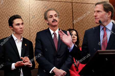 Richard Blumenthal, Mike Feuer, David Hogg. David Hogg, a student at Marjory Stoneman Douglas High School, left, takes notes on his hand while listening to Sen. Richard Blumenthal, D-Conn., right, speak about gun violence, as survivors of gun violence, congressional lawmakers, and advocates, urged Congress to pass gun safety legislation ahead of the Saturday March For Our Lives, on Capitol Hill in Washington. At center is Los Angeles City Attorney Mike Feuer