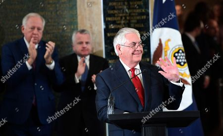Outgoing Secretary of State Rex Tillerson waves as he speaks to employees of the State Department in Washington, upon his departure