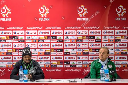 Nigerian national soccer team's German head coach Gernot Rohr (R) and his player Ogenyi Onazi (L) attend a press conference in Wroclaw, Poland, 22 March 2018. Nigeria will play Poland on 23 March in international friendly soccer match.