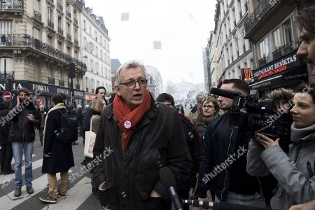 General secretary of the communist party Pierre Laurent speaks to journalists during a demonstration