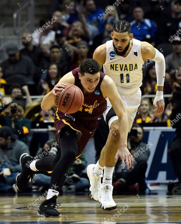 Loyola-Chicago guard Ben Richardson (14) moves against Nevada forward Cody Martin (11) during the first half of a regional semifinal NCAA college basketball game, in Atlanta