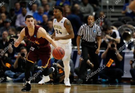 Loyola-Chicago guard Ben Richardson (14) moves the ball against Nevada during the second half of a regional semifinal NCAA college basketball game, in Atlanta