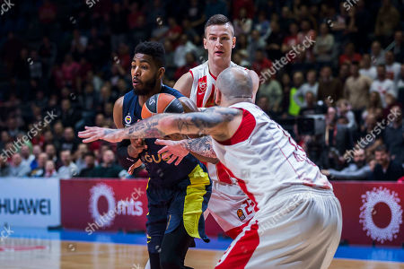 Center Jason Thompson of Fenerbahce Dogus Istanbul is challenged by Center Pero Antic of Crvena Zvezda mts Belgrade