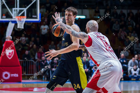 Center Jan Vesely of Fenerbahce Dogus Istanbul in action against Center Pero Antic of Crvena Zvezda mts Belgrade