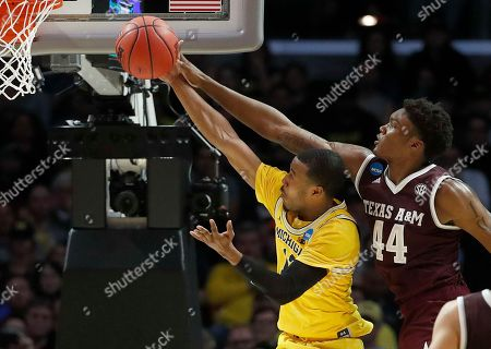 Michigan guard Muhammad-Ali Abdur-Rahkman, left, shoots in front of Texas A&M forward Robert Williams during the second half of an NCAA men's college basketball tournament regional semifinal, in Los Angeles