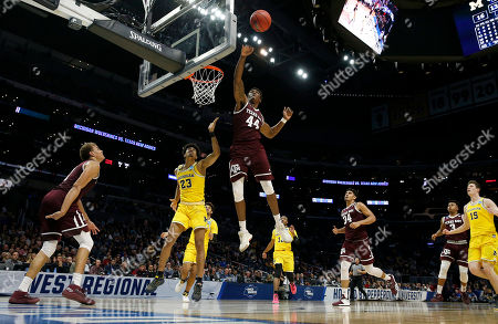 Texas A&M forward Robert Williams (44) reaches for the ball against Michigan during the first half of an NCAA men's college basketball tournament regional semifinal, in Los Angeles