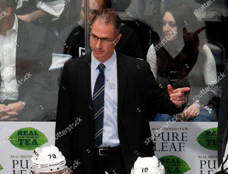 Los Angeles Kings coach John Stevens gestures to his team during the third period against the Colorado Avalanche in an NHL hockey game, in Denver. The Kings won 7-1