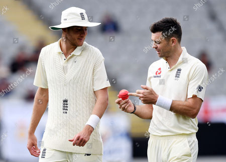 Chris Broad, James Anderson. England's Stuart Broad, left and James Anderson discuss the pink ball against New Zealand during the first cricket cricket test in Auckland, New Zealand