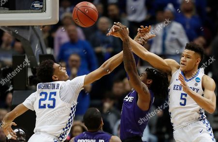 Kentucky's Kevin Knox (5) and PJ Washington (25) defend against Kansas State guard Cartier Diarra (2) during the first half of a regional semifinal NCAA college basketball tournament game, in Atlanta