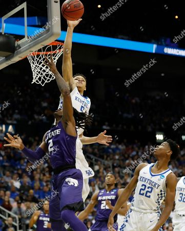 Kentucky forward Kevin Knox (5) blocks a shot by Kansas State guard Cartier Diarra (2) during the first half of a regional semifinal NCAA college basketball tournament game, in Atlanta