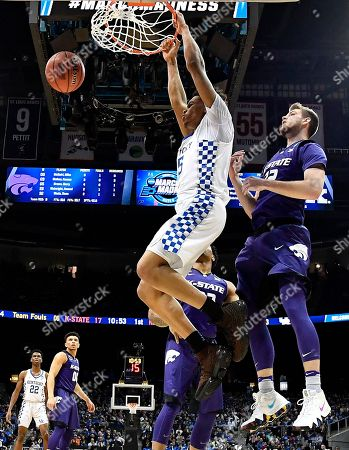 Kentucky forward Kevin Knox (5) dunks the ball against Kansas State forward Dean Wade (32) during the first half of a regional semifinal NCAA college basketball tournament game, in Atlanta