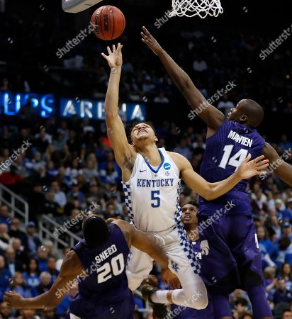 Kentucky forward Kevin Knox (5) shoots against Kansas State's Xavier Sneed (20) and Makol Mawien (14) during the second half of a regional semifinal NCAA college basketball tournament game, in Atlanta