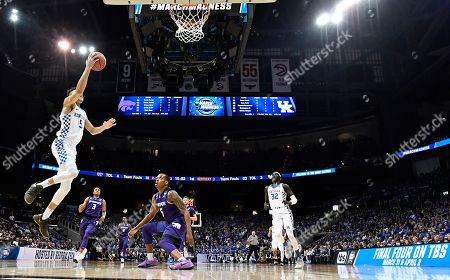 Kentucky forward Kevin Knox (5) shoots against Kansas State during the first half of a regional semifinal NCAA college basketball tournament game, in Atlanta