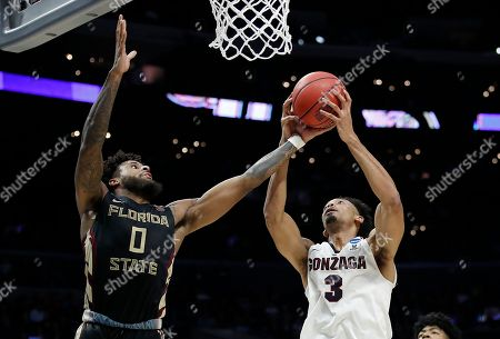 Gonzaga forward Johnathan Williams (3) grabs a rebound in front of Florida State forward Phil Cofer (0) during the second half of an NCAA men's college basketball tournament regional semifinal, in Los Angeles