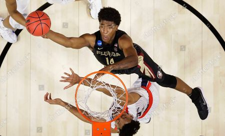 Florida State guard Terance Mann (14) shoots against Gonzaga forward Johnathan Williams during the second half of an NCAA men's college basketball tournament regional semifinal, in Los Angeles
