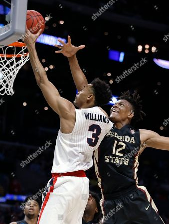 Gonzaga forward Johnathan Williams (3) shoots as Florida State center Ike Obiagu (12) defends during the first half of an NCAA men's college basketball tournament regional semifinal, in Los Angeles