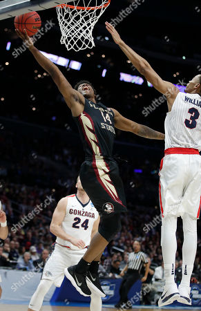 Florida State guard Terance Mann (14) shoots against Gonzaga forward Johnathan Williams (3) during the first half of an NCAA men's college basketball tournament regional semifinal, in Los Angeles