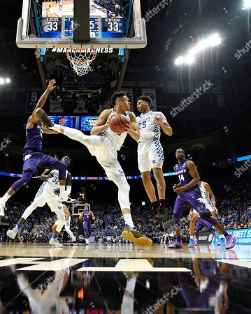 Kentucky forward Kevin Knox (5) makes a rebound against Kansas State during the second half of a regional semifinal NCAA college basketball tournament game, in Atlanta. Kansas State won 61-58